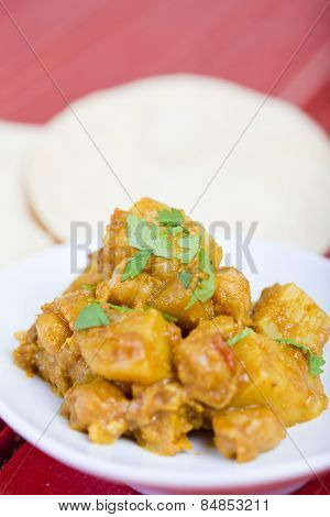 Bombay potatoes in a rich aromatic curry sauce