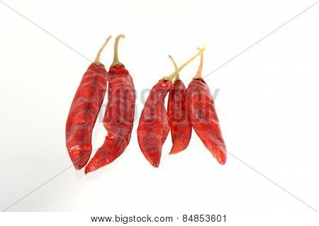 Red Chilli peppers isolated on white