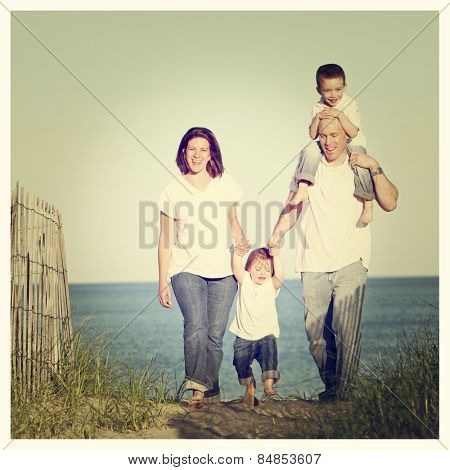 Good looking family going for a walk at the beach at sunset with Instagram effect filter