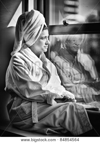 Pretty woman in bathrobe in high contrast black and white
