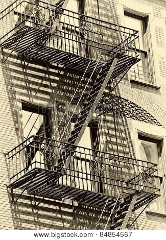 Old urban New York building with fire escape in new york , monotone