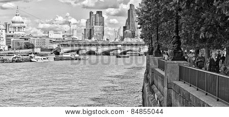 LONDON, UK - AUG 22, 2014: Panoramic view of London's River Thames and South Bank promenade in black and white