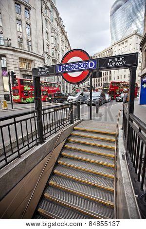 LONDON, UK - AUG 22, 2014: London Underground Monument Station entrance and signage. The London Underground sign is a famous London icon.