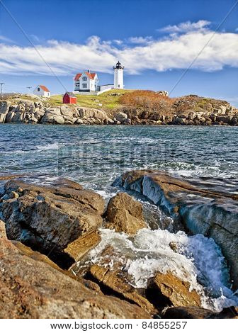 Lighthouse on top of a rocky island in Maine