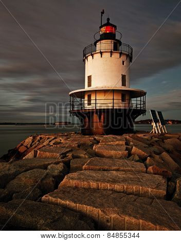 Lighthouse on top of a rocky island slow exposure