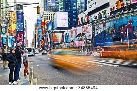 NEW YORK, USA - NOVEMBER 13th, 2014: Traffic driving through New York's famous Times Square area with colorful signage.