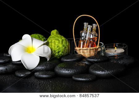 Aromatic Spa Setting Of Bergamot Fruits, Candles, Plumeria Flower And Bottles Essential Oil On Zen S