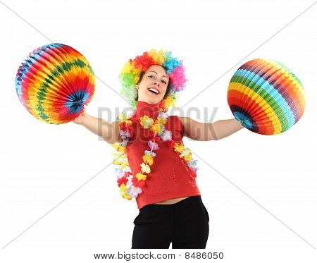Young Beauty Woman In Clown Wig, Flower Garland And Multicolored Decorative Balls, Laughing