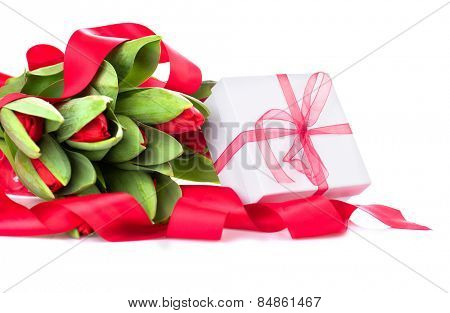 Spring Tulip Flowers bouquet and gift box over white. Mother's Day or Easter Tulips bunch decorated with red satin ribbon. Floral Border Design. Isolated on a white background