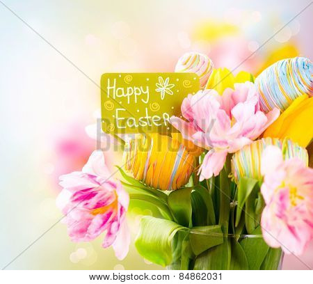 Easter Holiday flowers bunch with greeting card. Colorful tulips flowers bouquet decorated with colourful eggs. Easter art design. Springtime