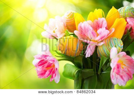 Easter Holiday flowers bunch with colourful eggs . Beautiful Colorful tulips flowers bouquet decorated with painted handmade eggs. Happy Easter art design. Springtime, Sunflare