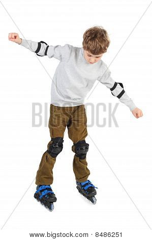 Little Boy In Blue Helmet Moving Hands At Sides And Rollerblading Isolated On White