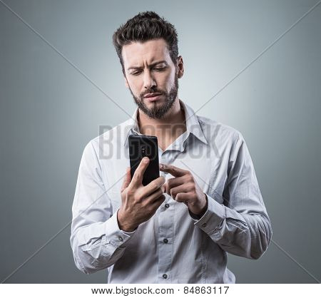 Disappointed Man Typing With His Smartphone