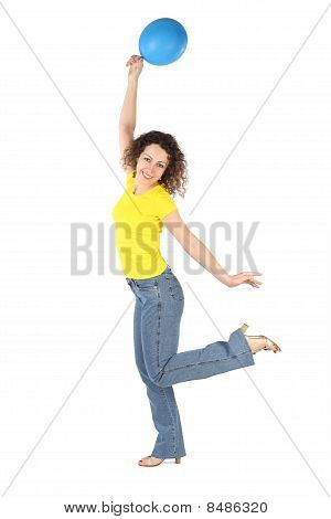 Young Attractive Woman In Yellow Shirt And Jeans With Blue Balloon Dancing Isolated On White