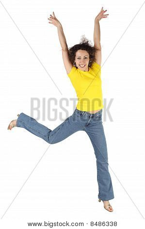 Young Attractive Woman In Yellow Shirt And Jeans Jumping And Smiling Isolated On White