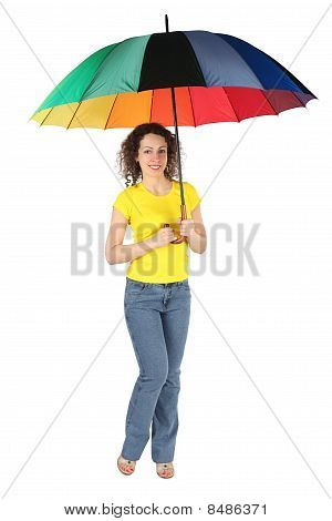 Young Beauty Woman With Toothy Smile In Yellow Shirt With Multicolored Umbrella Standing Isolated