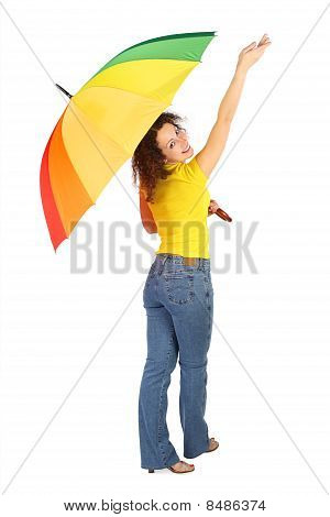 Young Beauty Woman In Yellow Shirt With Multicolored Umbrella Standing With Reached Out A Hand