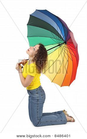 Young Attractive Woman In Yellow Shirt With Multicolored Umbrella Sitting Isolated On White And Look