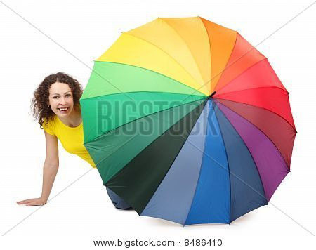 Young Attractive Woman In Yellow Shirt Sitting On White Background And Looking Out Of Umbrella
