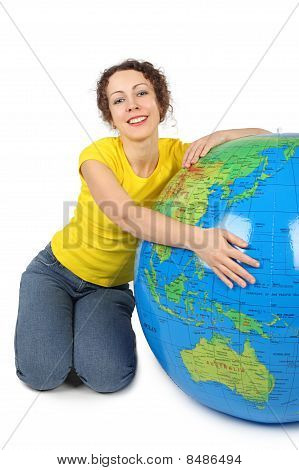 Young Beauty Woman Sitting Near Big Inflatable Globe And Smiling