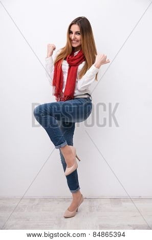 Full length portrait of a cheerful casual woman