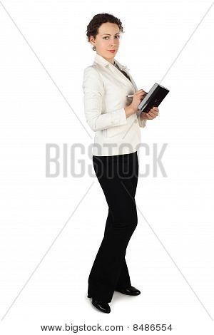 Young Beauty Brunette Woman In Business Dress, Standing And Holding Notebook And Pen, Isolated