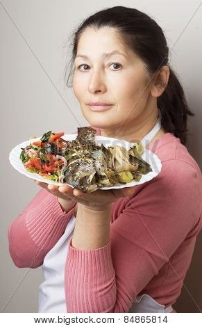 Woman-cook cooking  trout