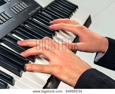 Hands Of Musician Playing On A Synthesizer, Isolated On A White