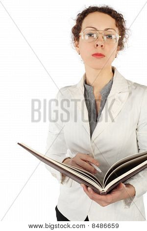 Young Serious Woman In Glasses Holding Big Book And Pen, Looking At Camera, Isolated On White