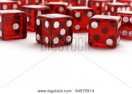 Many red semi transparent dice with selective focus on white background.