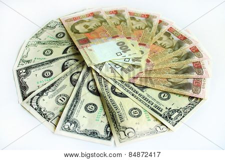 Dollars And Grivnas Banknotes Isolated On Dark Background