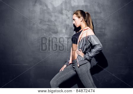 young fitness woman stretching, trained female body, caucasian model