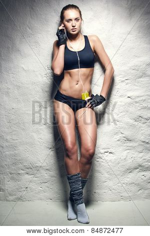 attractive fitness woman with mp3 player, caucasian brunette model