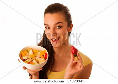 Beautiful Happy Asian Caucasian Woman In Yellow T Shirt Eating Fruit Salad As A Healthy Lifestyle Co