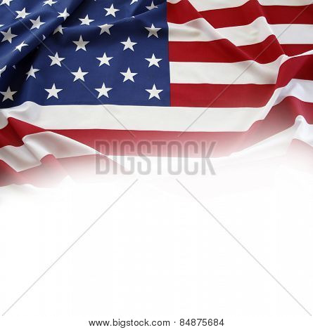 Closeup of American flag on plain background