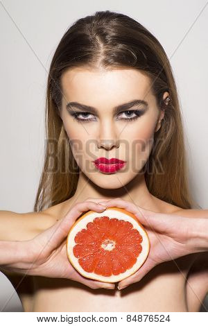 Glamour Girl Holding Grapefruit
