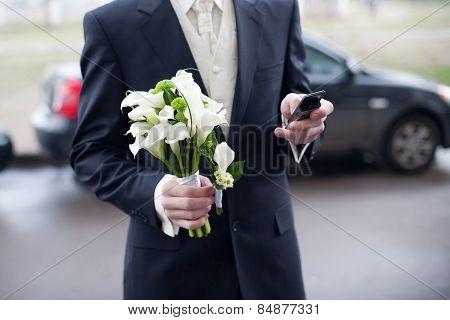 Groom With Wedding Bouquet