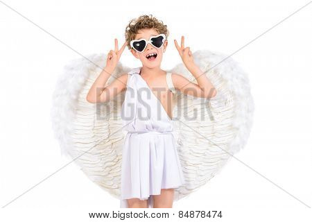 Cute emotional little boy in a costume of angel. Cupid. Valentine's day. Isolated over white.
