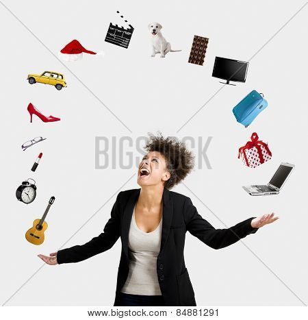 A Beautiful Afro-American woman juggling multiple objects over the air