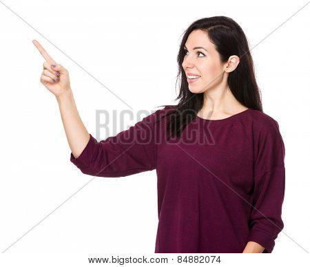 Brunette woman stare at the finger point up