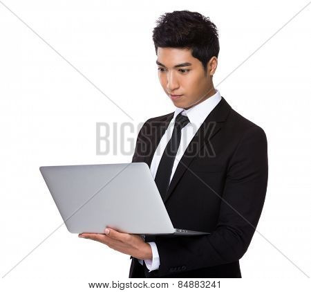 Mixed Indian businessman use of laptop