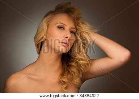 Beauty Portrait Of A Pretty Caucasian Woman With Blond Hair Over Grey Background