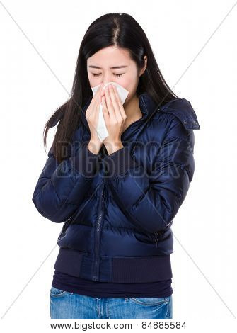 Young woman sneeze