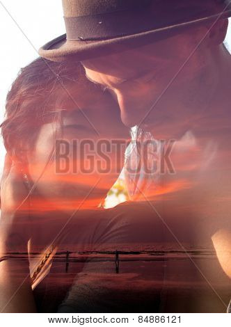 Double exposure portrait of tender couple mixed with  sunset scene