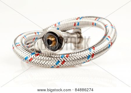 Reinforced water hose on white background.