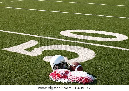 American Football, Helmet And Pom Poms On Field