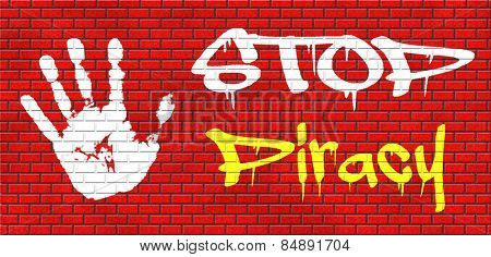 piracy stop illegal download of movies and music and illegal copying copyright and intellectual property protection protect copy of trademark brand graffiti on red brick wall, text and hand