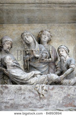 VIENNA, AUSTRIA - DECEMBER 10: Jesus is laid in the tomb and covered in incense. Architectural details from the external walls of St Stephen's Cathedral in Vienna, Austria on December 10, 2014.