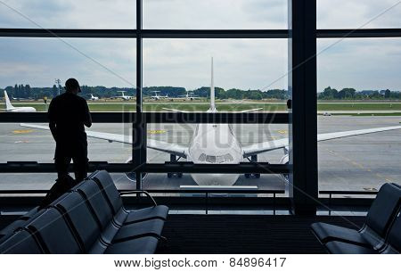 Man at the Airport with a view of the plane