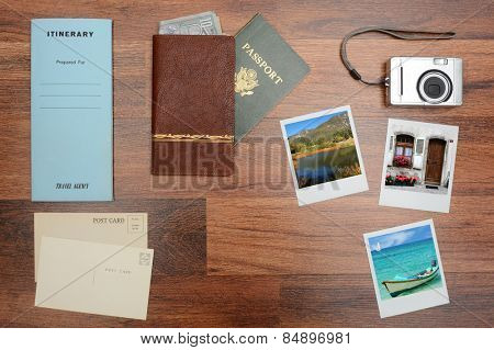 High angle shot of a passport, wallet, post cards, camera, pictures, and itinerary folder on a wood desk. Horizontal format with copy space in the middle. Photos could easily replaced with yours.